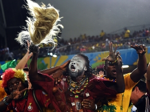 Ghana's fans cheer before the start of a Group G football match between Ghana and US at the Dunas Arena in Natal during the 2014 FIFA World Cup on June 16, 2014. AFP PHOTO / CARL DE SOUZA