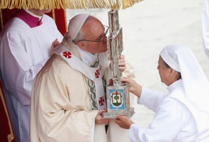 """Pope Francis kisses the relics of blessed Maria Guadalupe Garcia Zavala, also known as """"Madre Lupita,"""" the Mexican co-founder of the Handmaids of St. Margaret Mary and the Poor, during her canonization Mass at the Vatican May 12. (CNS photo/Tony Gentile, Reuters) (May 13, 2013) See POPE-SAINTS May 13, 2013."""