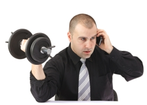 Adult business man on the phone doing fitness at work.White background