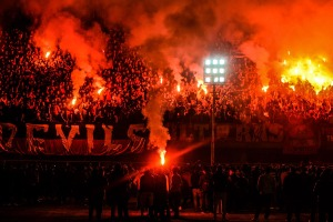 In this Feb. 1, 2015 photo, hardcore soccer fans known as Ultras Ahlawy, light flares and cheer during the third anniversary of people who were killed in the 2012 Port Said soccer riot, at Al -Ahly Sporting Club in Cairo, Egypt. On Feb. 1, 2012 over 70 people were killed in Port Said when Ahly fans were attacked by supporters of Port Said's football team Masry, who stormed the pitch at the end of the match. (AP Photo/Mohammed El Raai) ORG XMIT: MER302