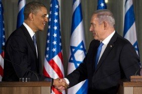Israeli Prime Minister Benjamin Netanyahu (R) and US President Barack Obama shake hands during a joint press conference at the Prime Minister's Residence in Jerusalem, March 20, 2013, on the first day of Obama's three day trip to Israel. AFP PHOTO / Saul LOEB (Photo credit should read SAUL LOEB/AFP/Getty Images)