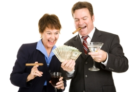 Business partners holding a wad of cash while smoking cigars and drinking cocktails. Isolated.