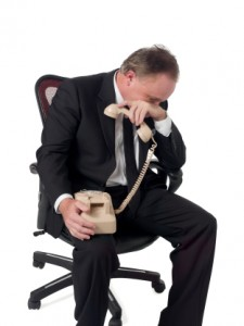 Kozzi-crying_businessman_while_holding_a_phone-312x416-225x300.jpg
