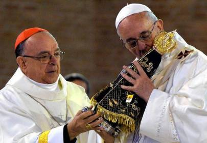 The archbishop of Aparecida, Raimundo Damasceno (L), gives a replica of the Our Lady of Aparecida to Pope Francis before he officiates mass at the Basilica of Our Lady of Aparecida, Brazil's most revered Catholic shrine, in Aparecida, Sao Paulo State, on July 24, 2013. The first Latin American and Jesuit pontiff is in Aparecida to lead his first big mass since arriving in the country for a week-long visit of which highlight is the huge five-day Catholic gathering World Youth Day. AFP PHOTO / NELSON ALMEIDANELSON ALMEIDA/AFP/Getty Images ** TCN OUT **
