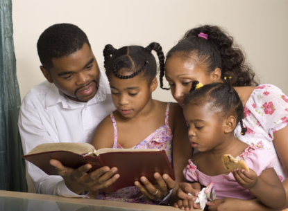 family_black_reading Bible-resized-600