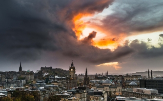 PIC FROM TOM FOSTER/MERCURY PRESS (PICTURED: Dragon/hand of God cloud formation) A doctor has caught on camera the moment what looked like a fire-breathing DRAGON appeared over the skies of Edinburgh. Tom Foster, 25, was taking pictures of the Scottish capital when he says the heavens opened and a giant raincloud appeared against the sunset. The junior doctor realised he had caught what looked like a dragon or even the hand of God' reaching down to grasp Edinburgh Castle in its flaming palm. SEE MERCURY COPY