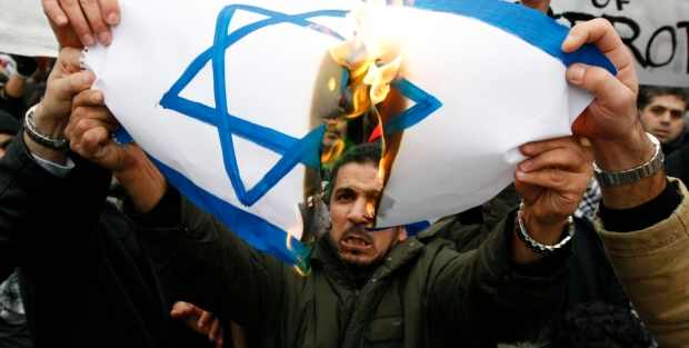 Protesters burn Israel flag in front of Israeli embassy during protest in Bern