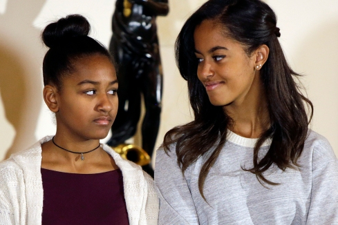 Sasha and Malia Obama listen to their father at the National Thanksgiving Turkey pardoning at White House in Washington